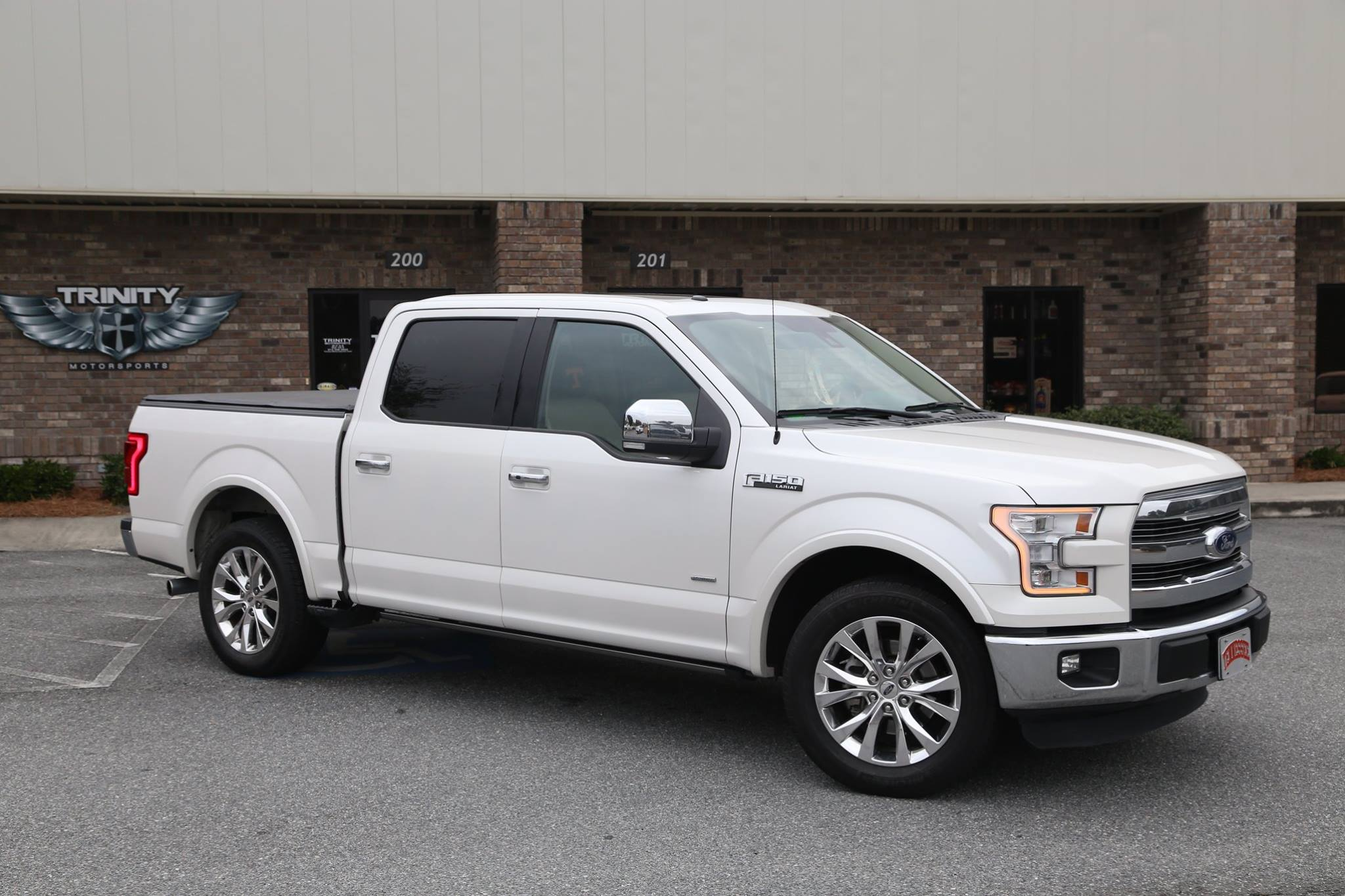 2015 f150 lariat on big blocks trinity motorsports. Black Bedroom Furniture Sets. Home Design Ideas