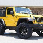 Lifted 2011 Jeep JK on KMC Buck Wheels